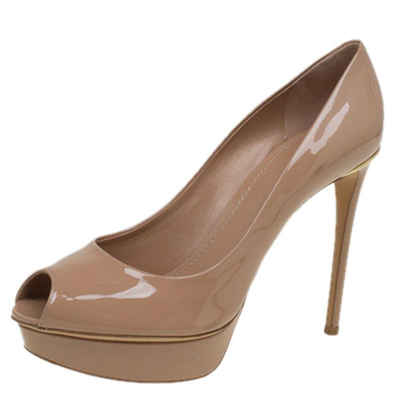 ff5ddcdf0fbd ... Patent Leather Eyeline Peep Toe Platform Pumps Size 39. nextprev.  prevnext