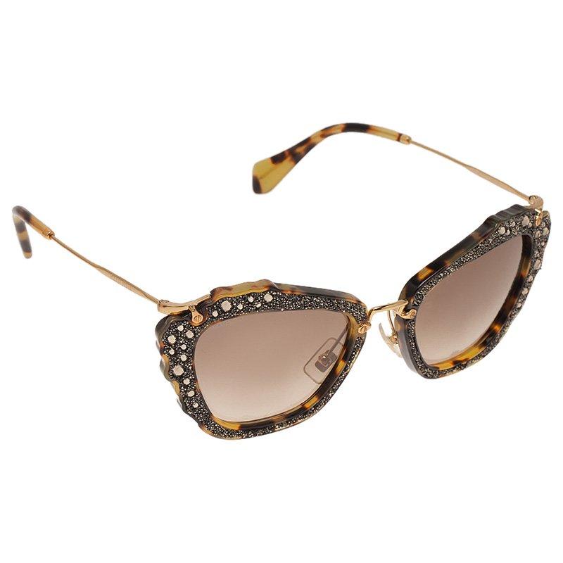 a147d727c5 ... Miu Miu Tortoise SMU 04Q Embellished Cat Eye Sunglasses. nextprev.  prevnext