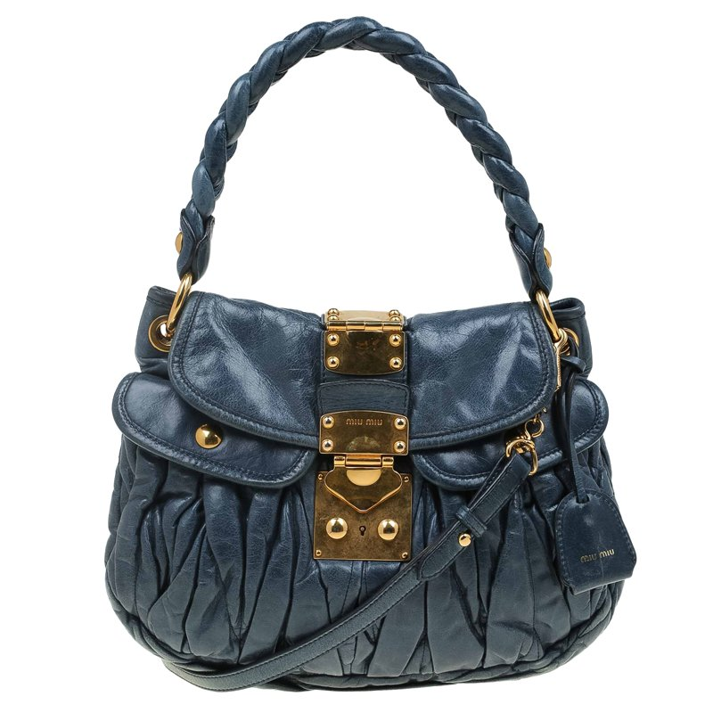 8f721c37cd2a ... Miu Miu Navy Blue Matelasse Lux Leather Small Coffer Hobo. nextprev.  prevnext