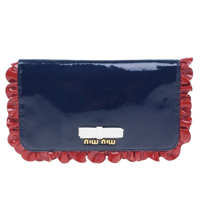 ... Miu Miu Navy Blue Patent Leather Ruffle Zip Around Wallet. nextprev.  prevnext 49d0ebba5a8b2