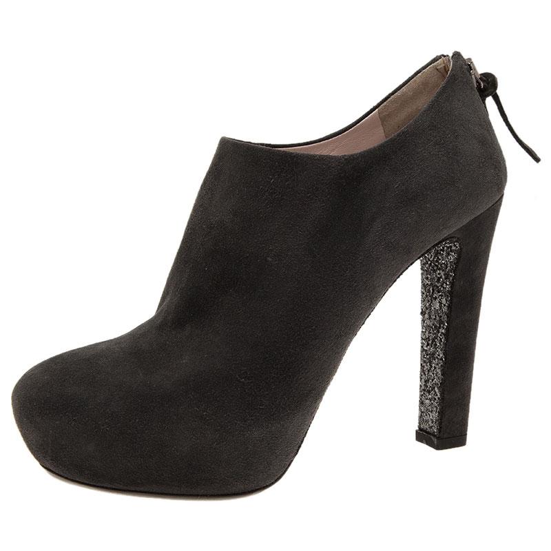 d5bfbac29af ... Miu Miu Grey Suede Glitter Heel Platform Ankle Boots Size 38. nextprev.  prevnext