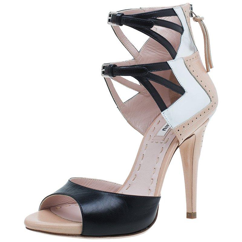 a7633dea5c0 ... Miu Miu Black and Beige Leather Double Ankle Strap Peep Toe Sandals  Size 36. nextprev. prevnext