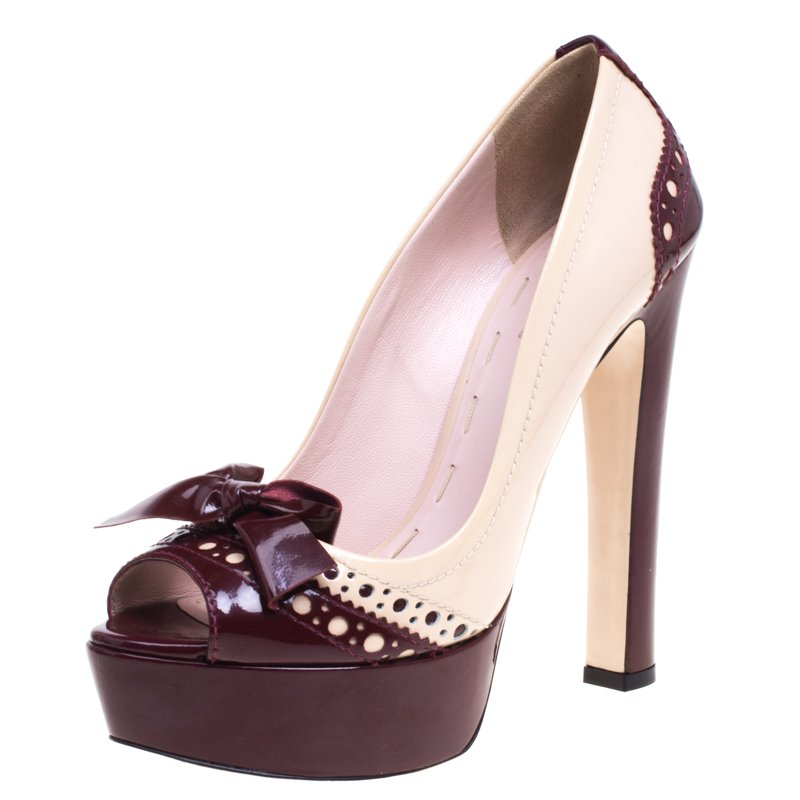 777fd5f0279 Buy Miu Miu Beige and Burgundy Brogues Patent Spectator Bow Platform ...