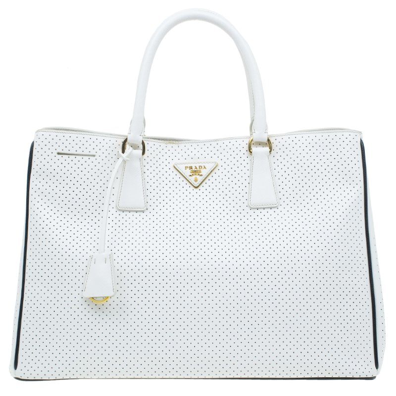 64602ae20b3d ... Prada White Perforated Saffiano Leather Medium Lux Tote. nextprev.  prevnext