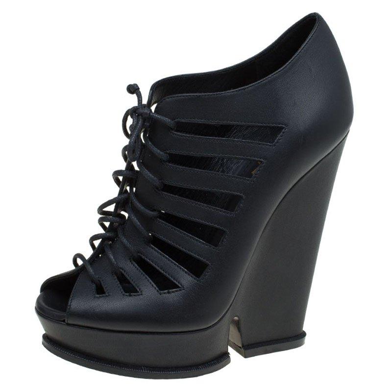92f98c73f18 Buy Saint Laurent Paris Black Leather Cut Out Hortense Wedge Boots ...