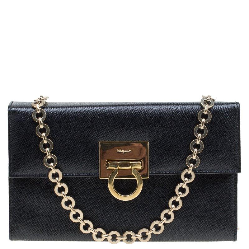 a337c4f575e ... Salvatore Ferragamo Black Leather Chain Clutch Bag. nextprev. prevnext