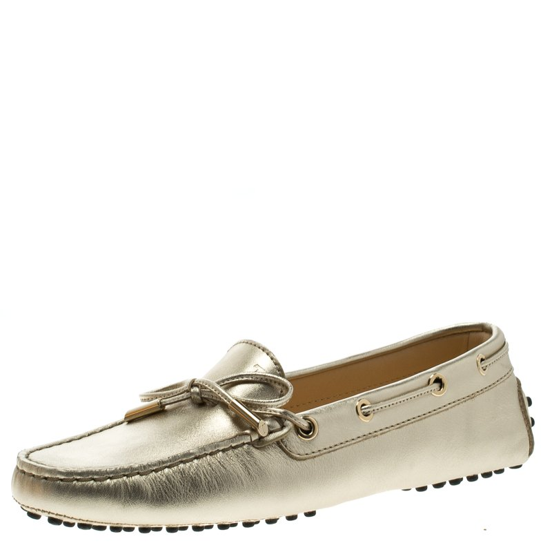 9be34693535 ... Tod s Metallic Gold Bow Detail Driving Loafers Size 36.5. nextprev.  prevnext