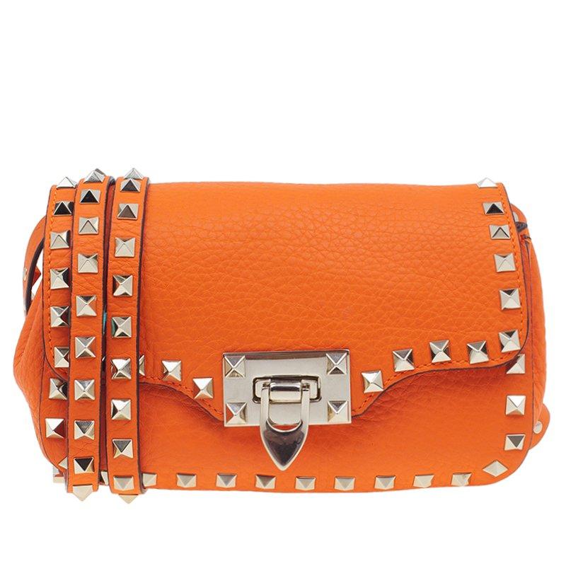 4c9ec7debc16 ... Valentino Orange Leather Small Rockstud Flap Crossbody Bag. nextprev.  prevnext