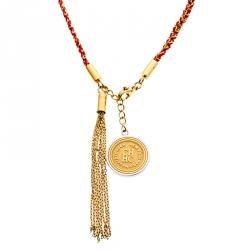 a2ca1b80cf8 Carolina Herrera Gold Tone Braided Medallion Pendant Tassle Necklace