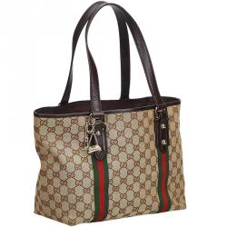 f6eb8a50dfe0 Buy Gucci Beige Brown GG Canvas and Leather Medium Charm Tote 143769 ...