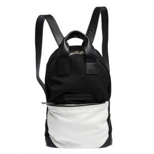 حقيبة ظهر أم سي كيو باي أليكساندر ماكوين جيب جلد ونايلون بيضاء/ سوداء