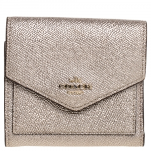 محفظة كوتش ثلاثية الطية كتل لونية جلد ذهبية روز