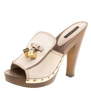 حذاء لوي فيتون مقدمة مفتوحة نعل سميك مرصع رهودز جلد كريمي مقاس 37.5
