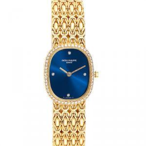 ساعة يد نسائية باتيك فيليب غولدن ايليبس 4698 ذهب أصفر عيار 18 زرقاء 22x24 مم