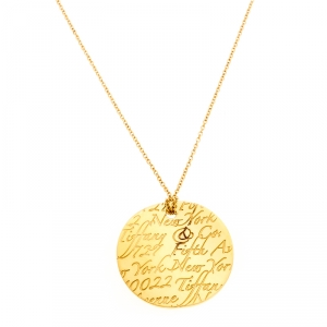 Tiffany & Co. Tiffany Notes Engraved 18k Yellow Gold Round Wave Pendant Necklace
