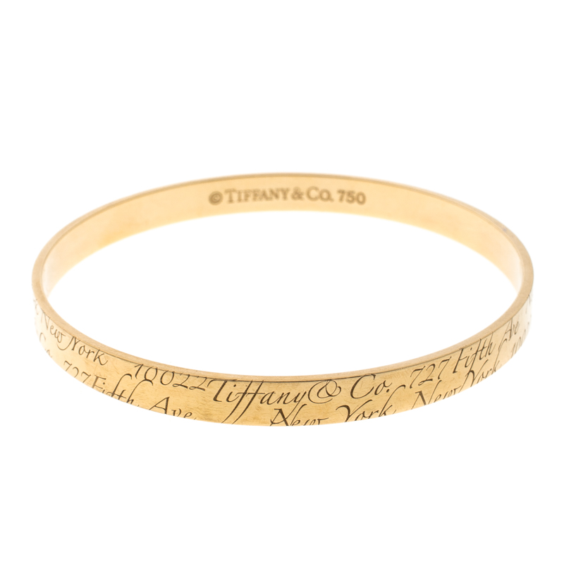 Купить со скидкой Tiffany & Co. Notes Engraved 18k Yellow Gold Narrow Bangle Bracelet 19cm