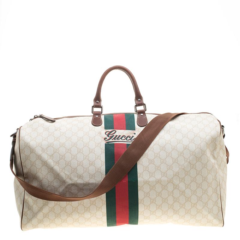 ba3f80fa3 ... Gucci Light Beige GG Supreme Canvas Web Duffle Bag. nextprev. prevnext