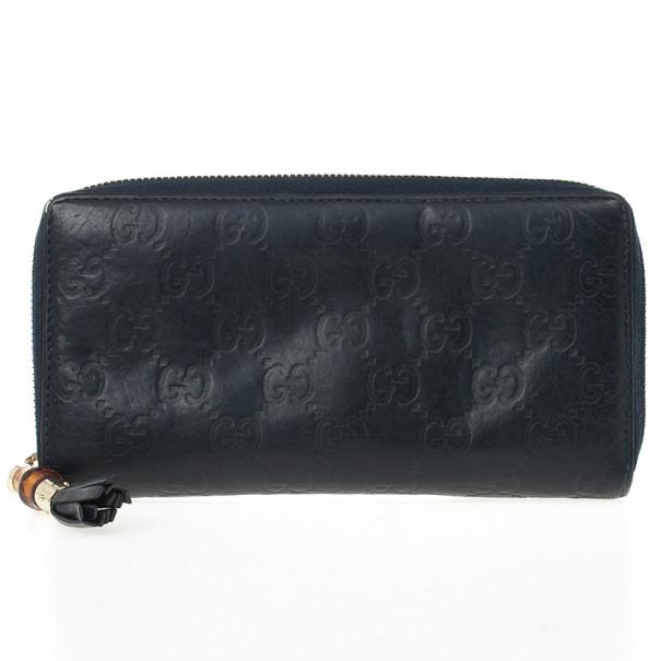 c0b6b611556ad4 ... Gucci Black Guccissima Zip Around Bamboo Tassel Wallet. nextprev.  prevnext