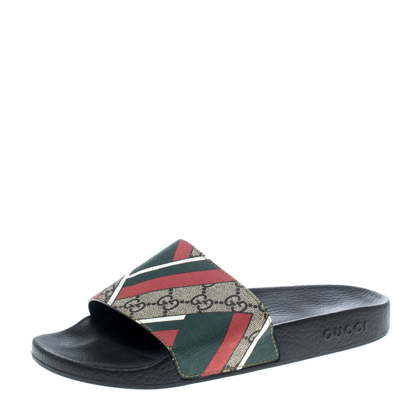 f9786951eff6 Buy Gucci Beige Web Print GG Supreme Canvas Flat Slide Sandals Size ...