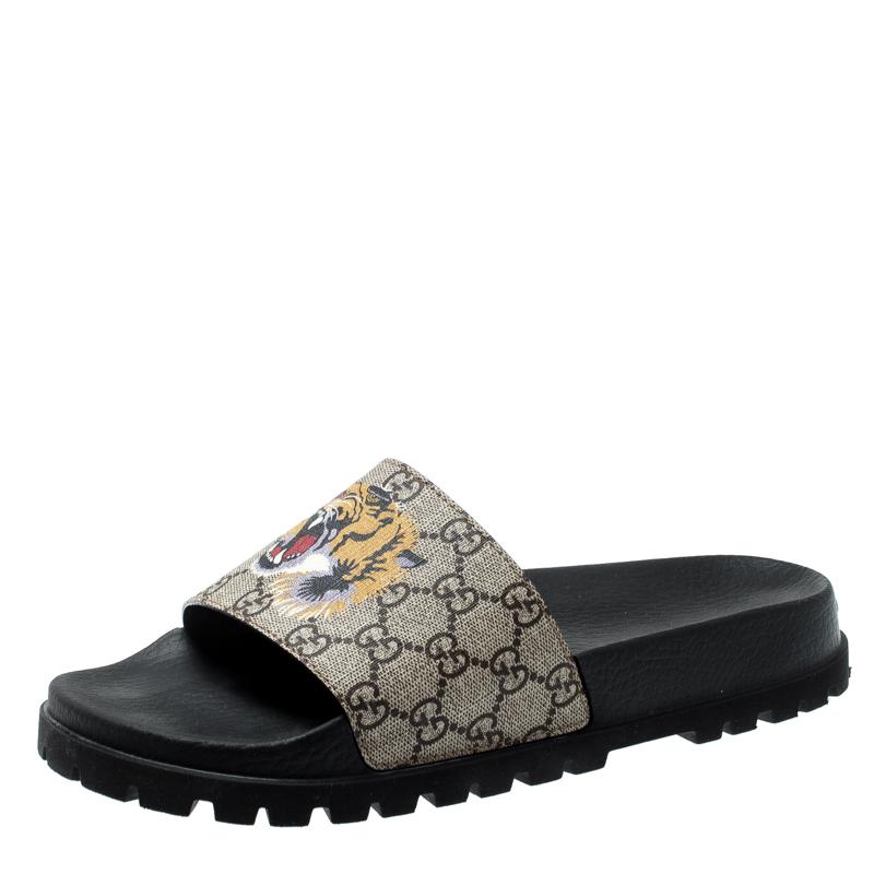 06682dfb8 ... Gucci Beige GG Supreme Canvas Tiger Print Sandals Size 43. nextprev.  prevnext