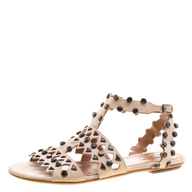 6626df369de1 Buy Alaia Beige Stud Embellished Cutout Suede Ankle Strap Flat ...
