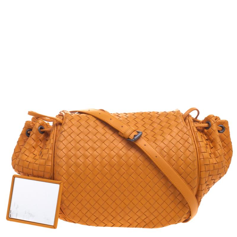 ... Bottega Veneta Orange Intrecciato Leather Drawstring Crossbody Bag.  nextprev. prevnext e64e004fab982