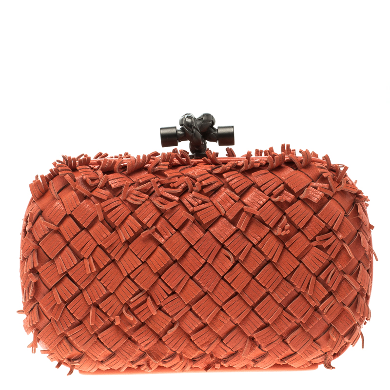 d32959de38 ... Bottega Veneta Orange Leather Fringe Knot Clutch. nextprev. prevnext