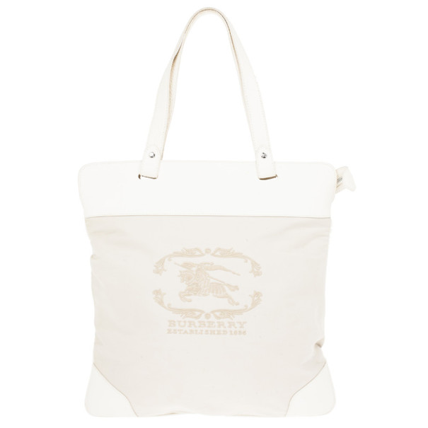 79a7cf095584 Buy Burberry Cream Canvas Stowell Roll Up Tote 15218 at best price