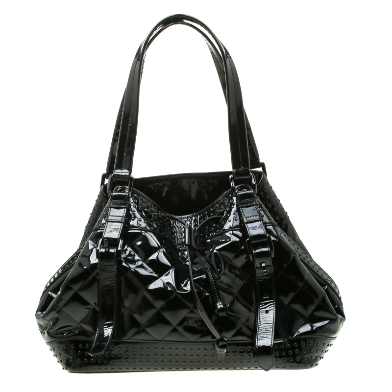5ce31a56246 ... Burberry Black Quilted Patent Leather Studded Lowry Tote. nextprev.  prevnext