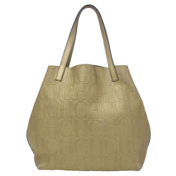 Buy Carolina Herrera Gold Monogram Leather Matryoshka Tote 11676 at ... 5fff1f59f4d6e