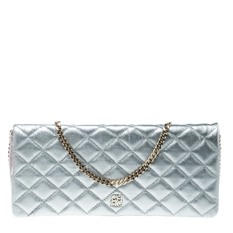 23834ee4d6600 ... Carolina Herrera Metallic Silver Quilted Leather Chain Clutch. nextprev.  prevnext
