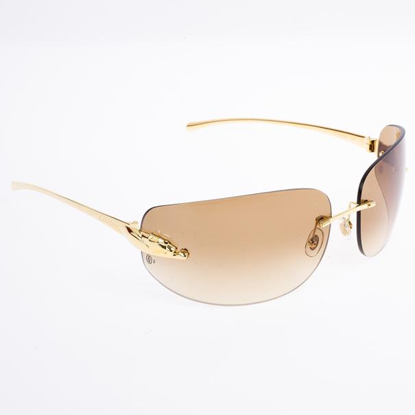 d656cc457b2 ... Cartier Gold Panthere De Cartier Shield Sunglasses. nextprev. prevnext