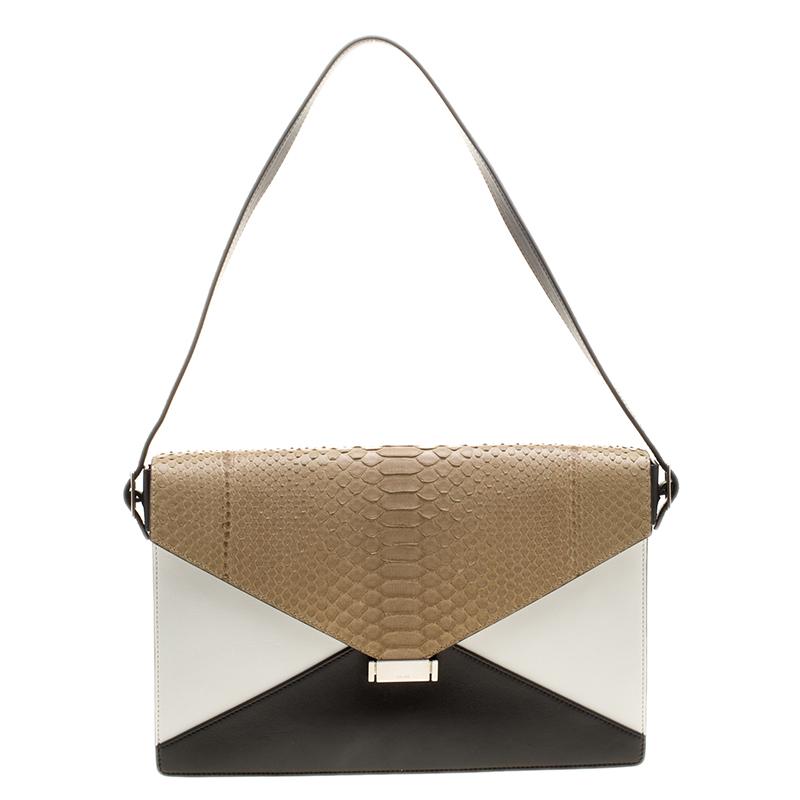 ... Celine Tricolor Leather and Python Skin Diamond Clutch Bag. nextprev.  prevnext 9fff83f8048e6