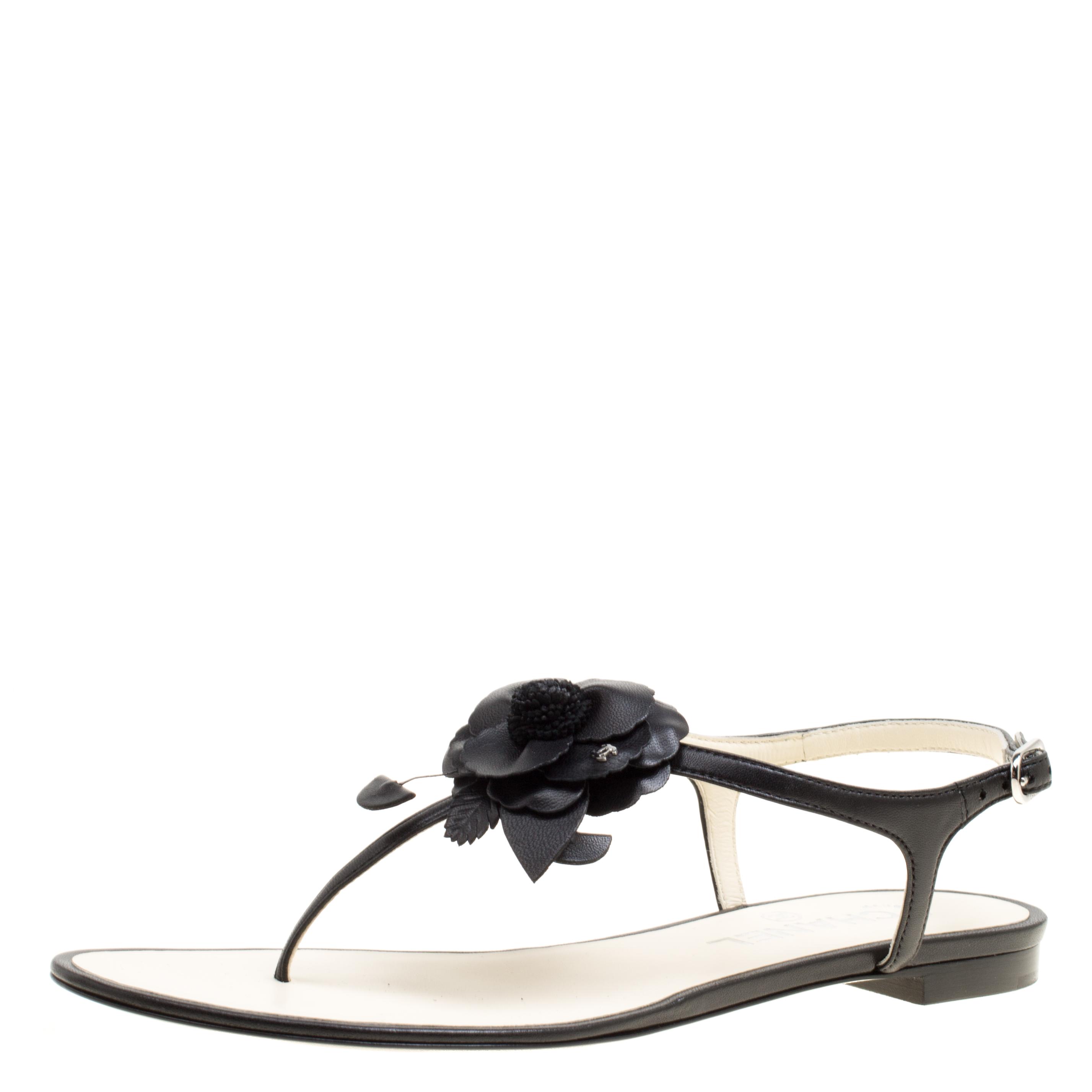 e8c7839dff455 ... Chanel Black Leather Camellia Flat Thong Sandals Size 38. nextprev.  prevnext