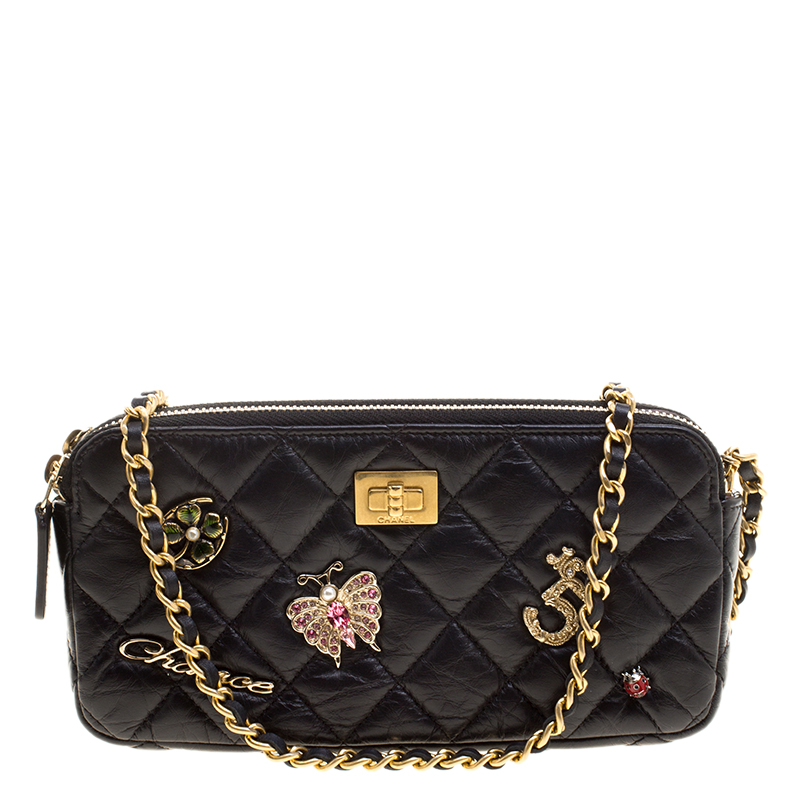 ae8cd589207f ... Chanel Black Quilted Leather Double Zip Charms WOC Clutch Bag.  nextprev. prevnext