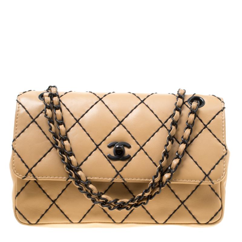 8bead7672dc3 ... Chanel Beige Quilted Leather Wild Stitch Surpique Flap Bag. nextprev.  prevnext