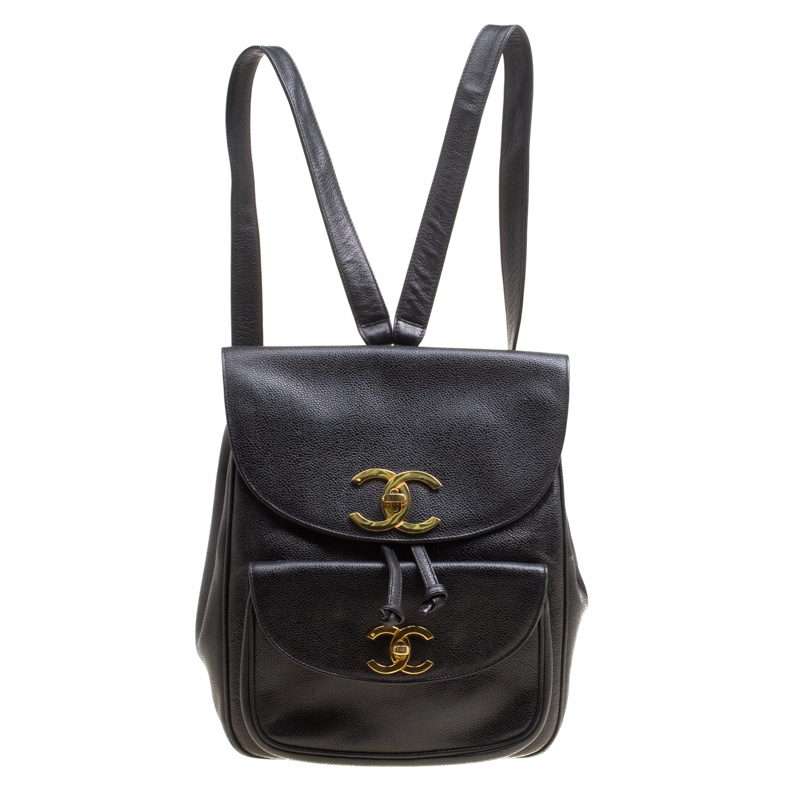 eaf756cc4335 ... Chanel Black Caviar Leather Vintage CC Drawstring Backpack. nextprev.  prevnext