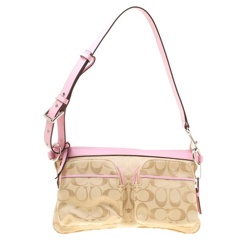 b4bc5b566b ... Coach Beige/Pink Signature Canvas and Leather Shoulder Bag. nextprev.  prevnext