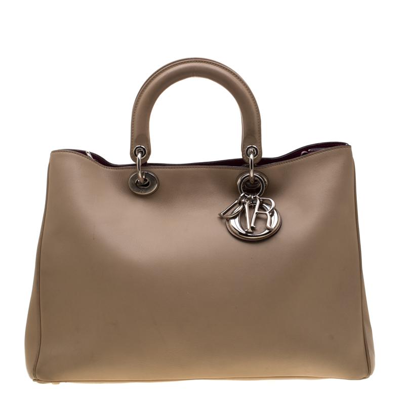ab9f71b9bc ... Dior Beige Leather Large Diorissimo Shopper Tote. nextprev. prevnext