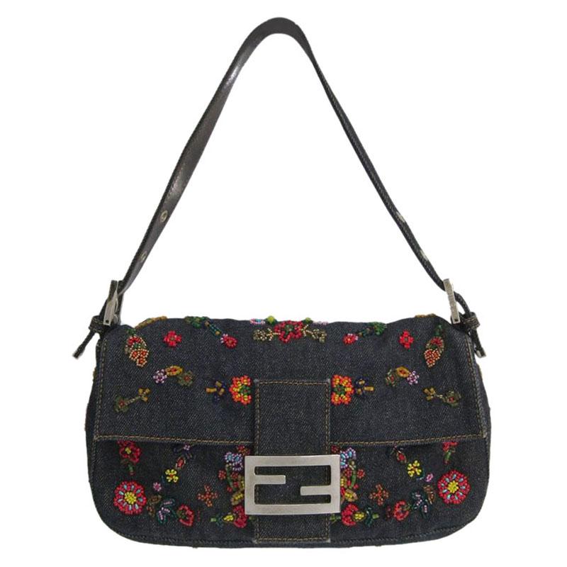 b107e7cf5c76 ... Fendi Blue Denim Embroidered Baguette Shoulder Bag. nextprev. prevnext