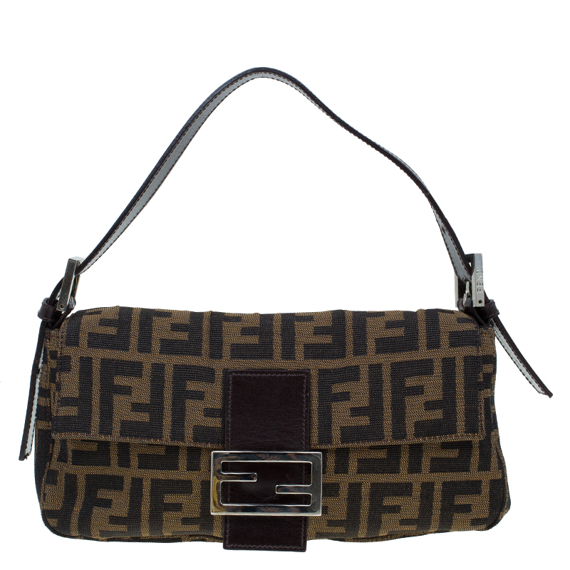 ... Fendi Tobacco Zucca Canvas Mini Mama Baguette Shoulder Bag. nextprev.  prevnext 221b686b59a38