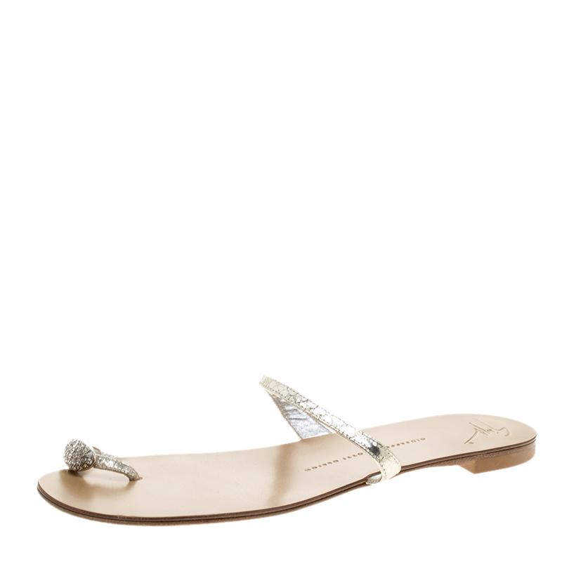 67aaf2c5f5447 ... Giuseppe Zanotti Metallic Silver Crystal Embellished Toe Ring Flat  Sandals Size 39. nextprev. prevnext