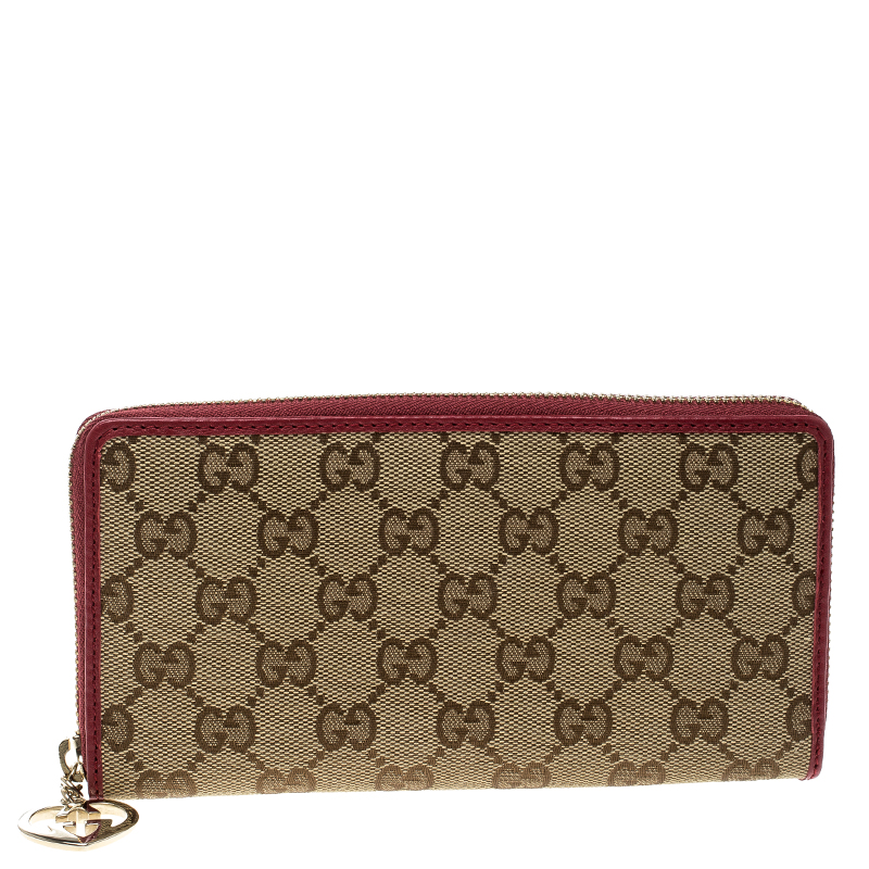 a3003fa1eff Buy Gucci Beige Red GG Canvas Zip Around Wallet 137753 at best price ...