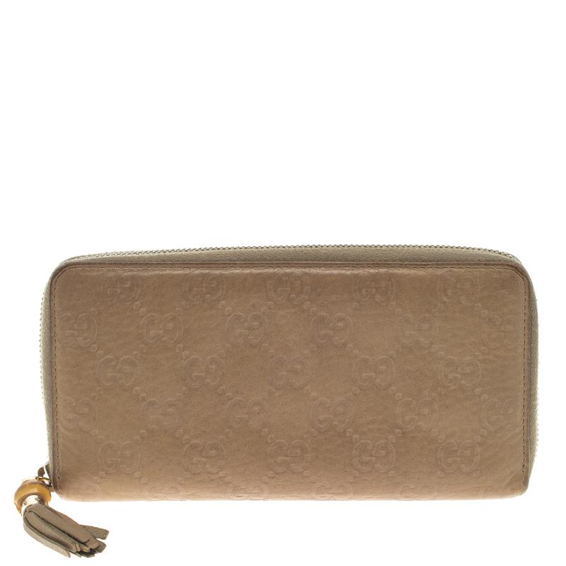 81d0c03b79a0 ... Gucci Beige Guccissima Leather Bamboo Tassel Zip Around Wallet.  nextprev. prevnext