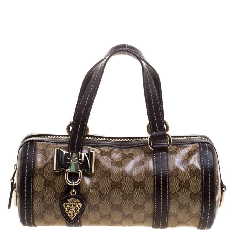 4c93fe9b2e Buy Gucci Beige/Ebony GG Crystal Canvas Small Duchessa Boston Bag ...