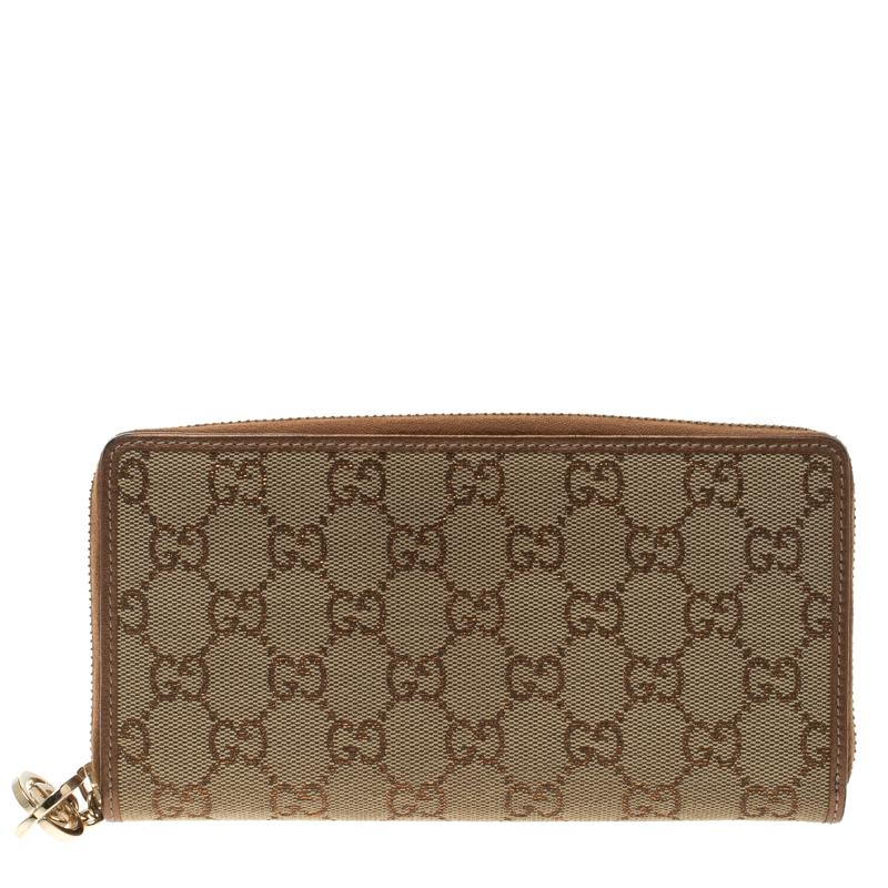 b2db2fa1627ca2 Buy Gucci Beige/Bronze GG Canvas Interlocking G Zip Around Wallet ...