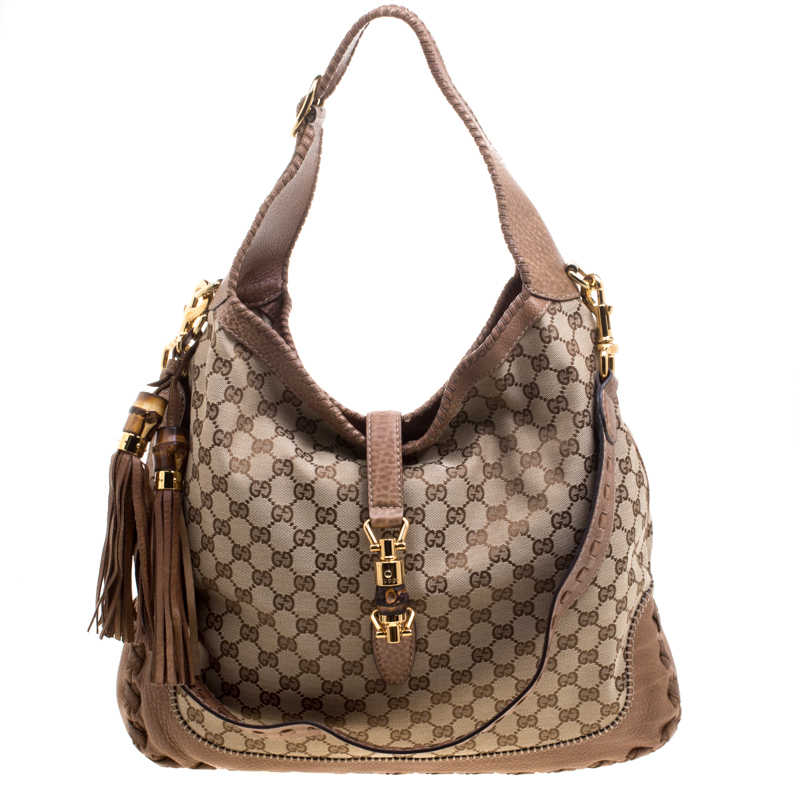 1934016c26e4 ... Gucci Beige GG Canvas and Leather Large New Jackie Hobo. nextprev.  prevnext