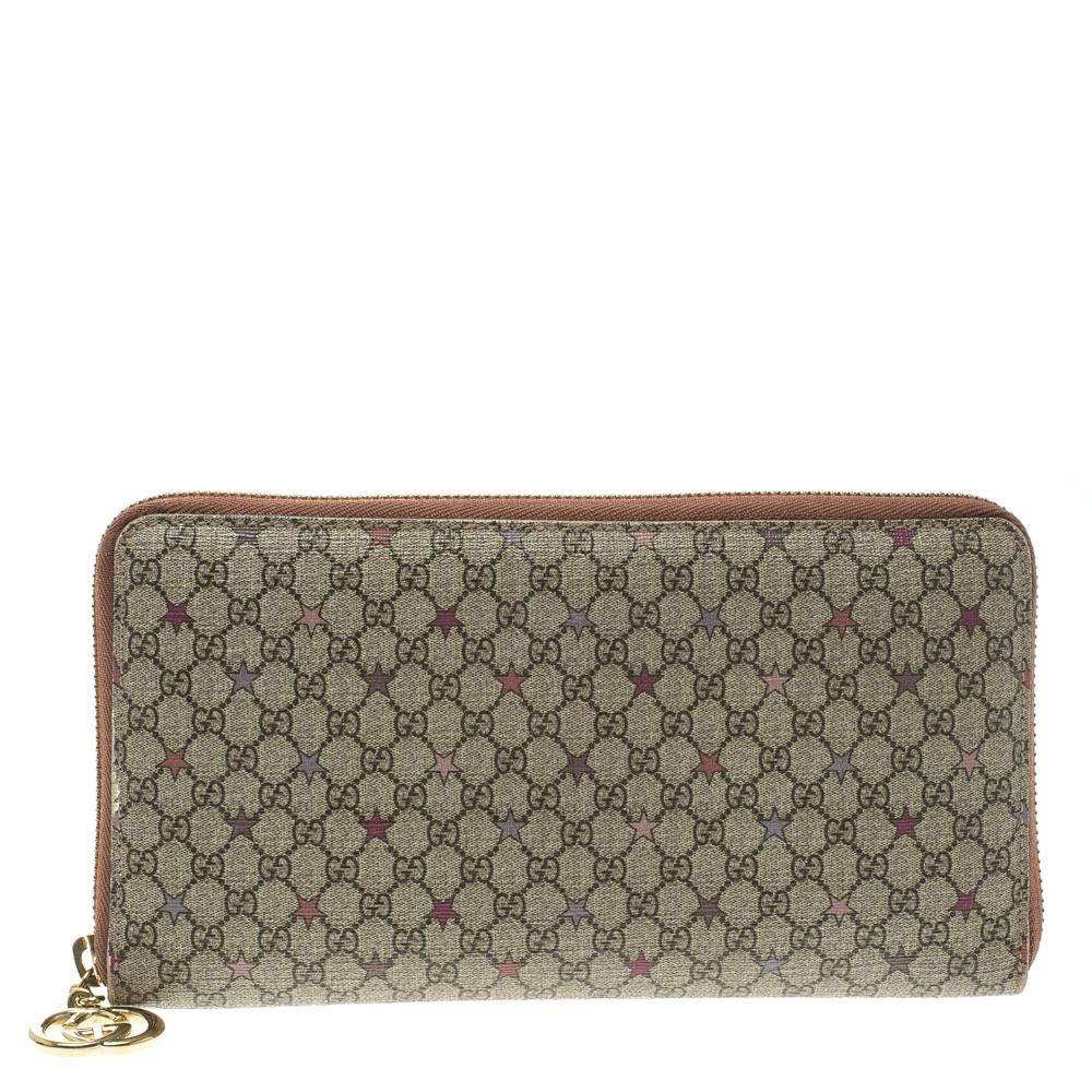 e9fb339486446a ... Gucci Beige GG Supreme Star Canvas Zip Around Wallet. nextprev. prevnext