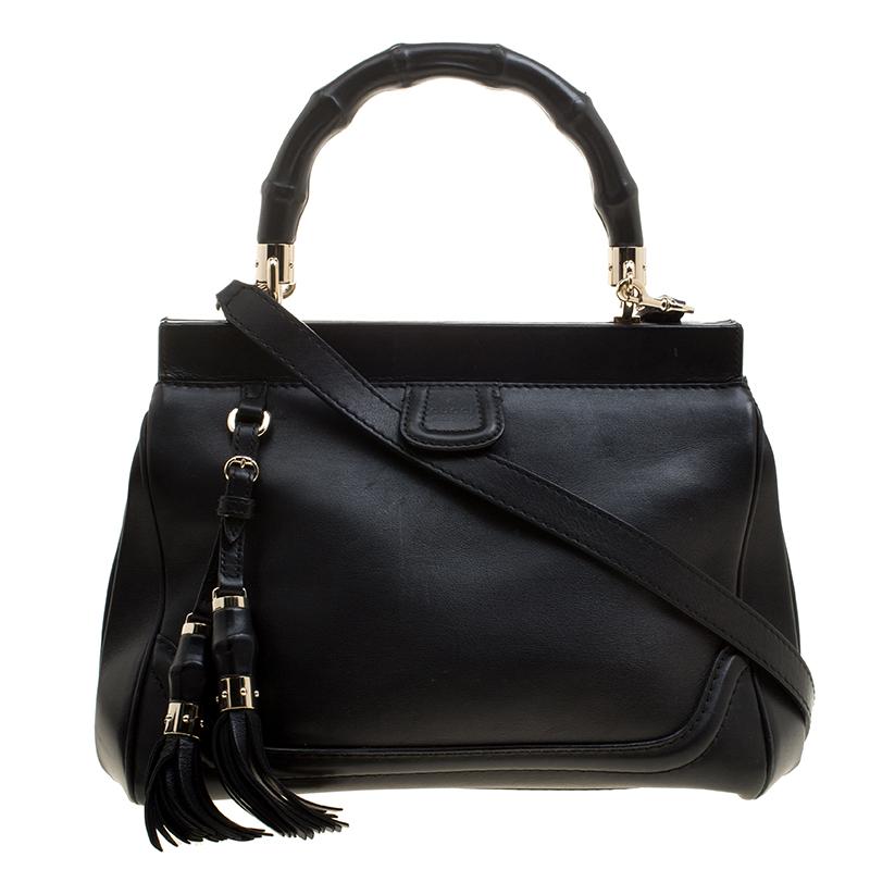 6b7fa6c9003b0 ... Gucci Black Leather Bold Bamboo Top Handle Bag. nextprev. prevnext