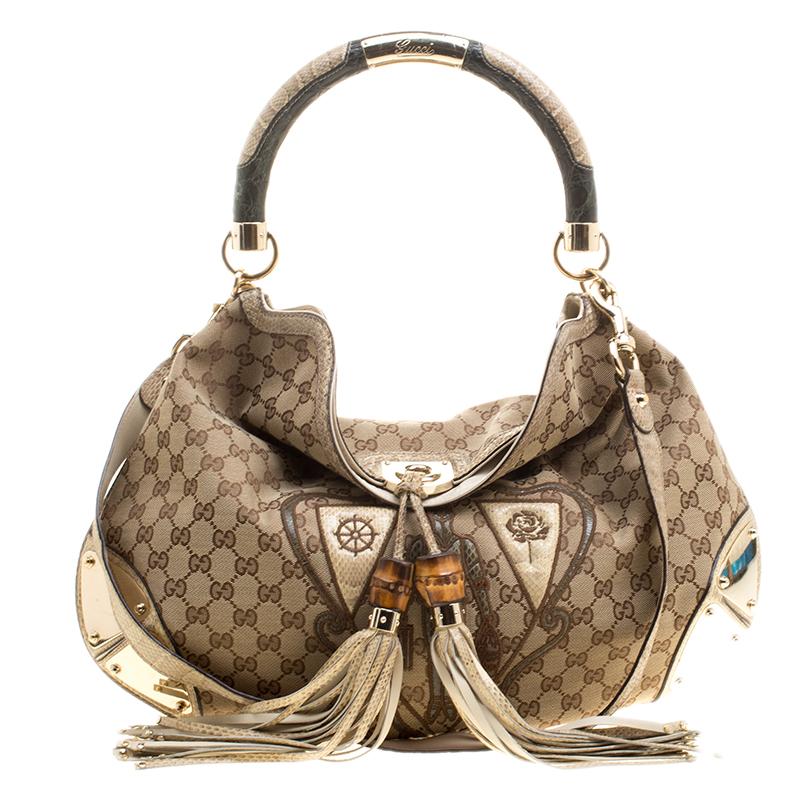 7bd24d7a05a35f ... Gucci Beige GG Canvas Limited Edition Crest Patchwork Indy Top Handle  Bag. nextprev. prevnext